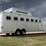 7 Horse Slant Load with Side Tack Doors and Fold Up Steps, Aerodyne Nose Enclosed Hay Rack with Ladder and Drop Down Doors with Windows.