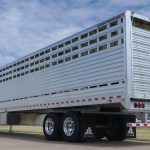Straight Floor Semi Stock Trailer - Standard 36 inch Roll Up Gate on Streetside with Permanent Pan on the Curbside with Reinforced Lower Roll Up Gate Panels