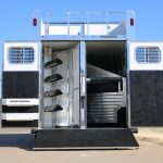 6 Horse Gooseneck Slant Load - Standard Double Rear Doors with Windows and Locking Seal Plate Latches (56/44) (Open), Integrated Hayrack with Rear Ladder and Cleats on Added Full Width Spring Loaded Rear Ramp (Down)